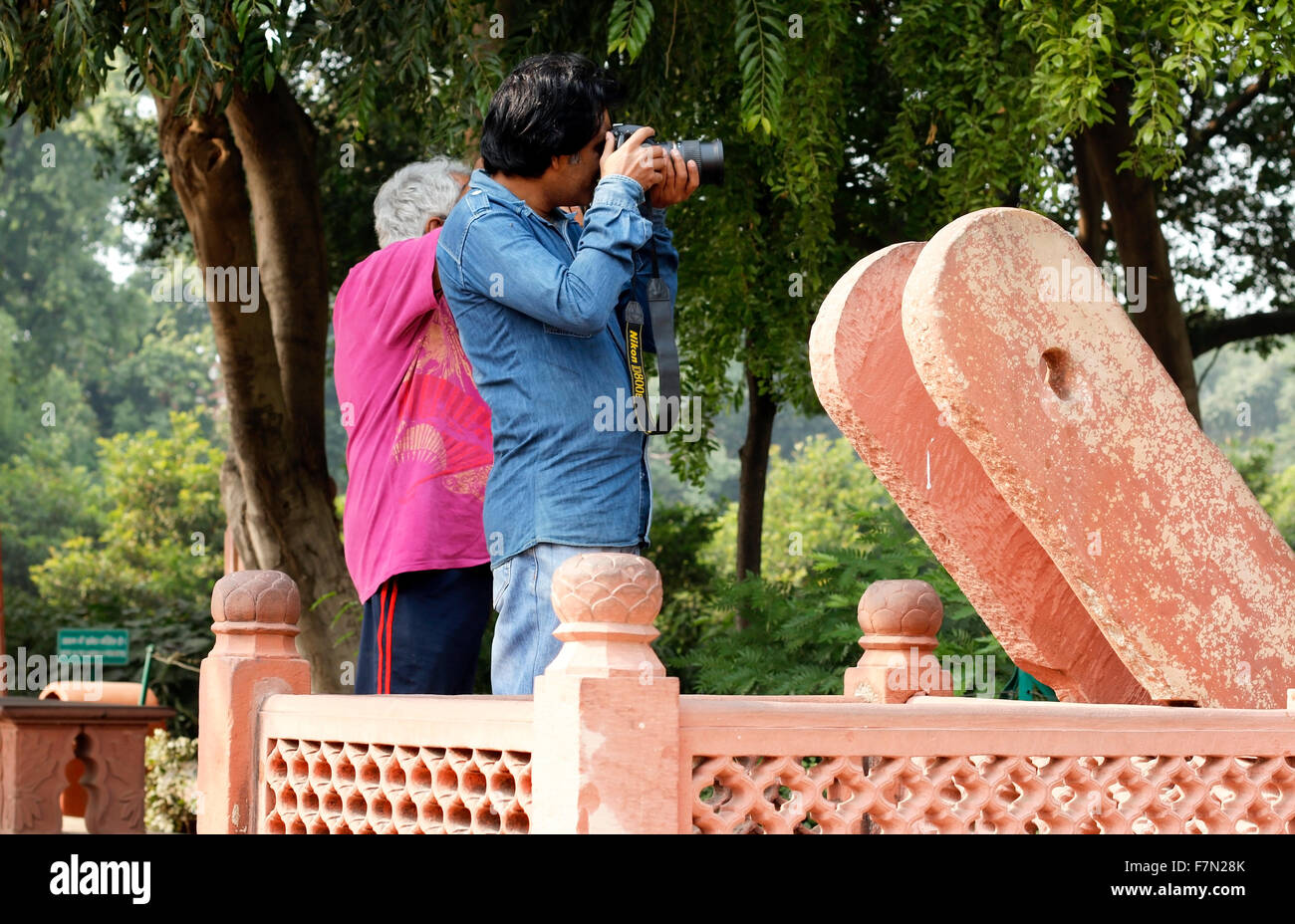 Two men capturing Taj near ancient Well - Stock Image