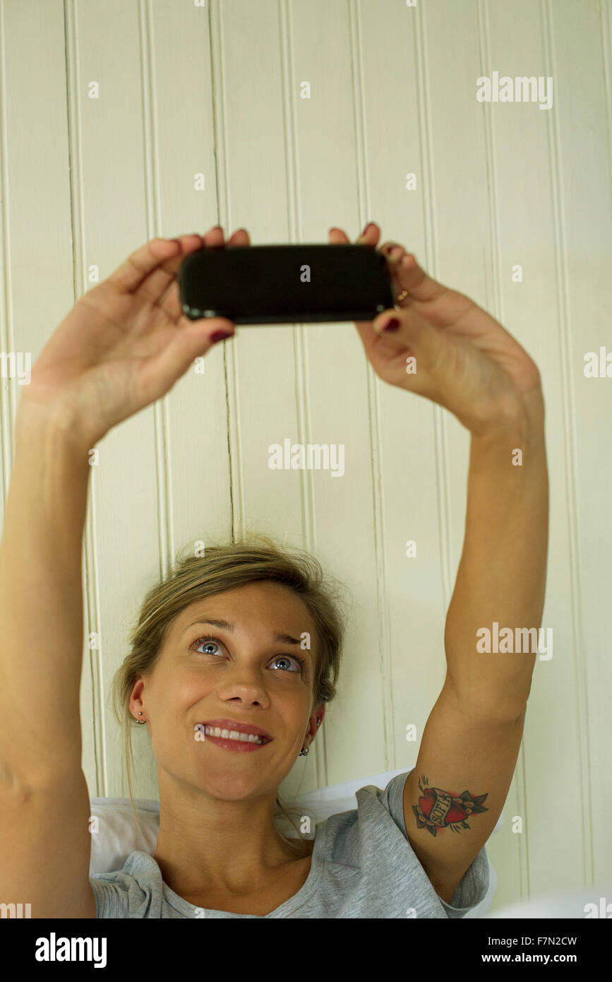 Woman taking selfie - Stock Image