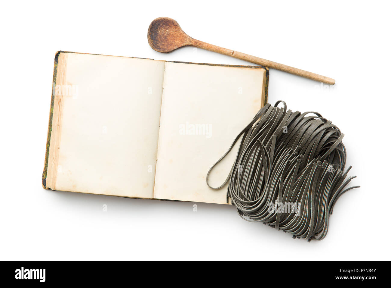 cookbook and black noodles with squid sepia ink on white background - Stock Image