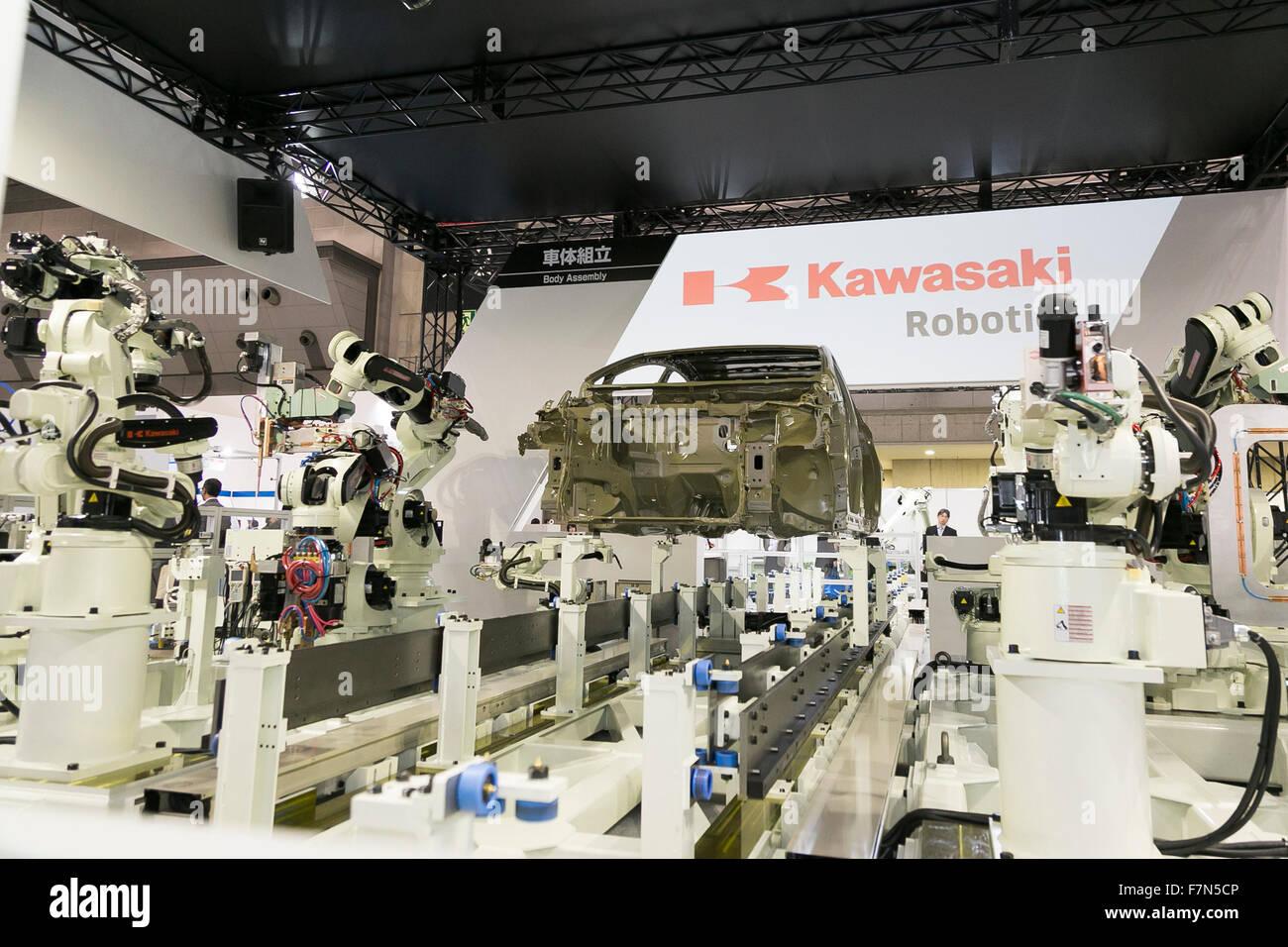 Kawasaki Heavy Industries Ltd.'s body assembly robots perform at the International Robot Exhibition 2015 on December Stock Photo