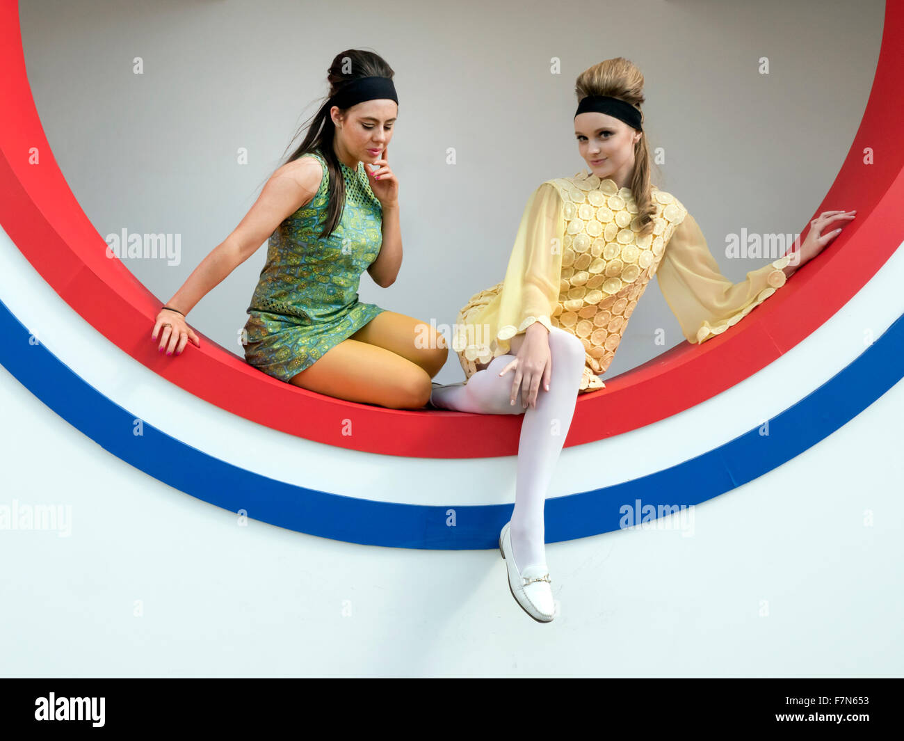 Girls in 1960's vintage fashion at the Goodwood Revival meeting 2015 - Stock Image