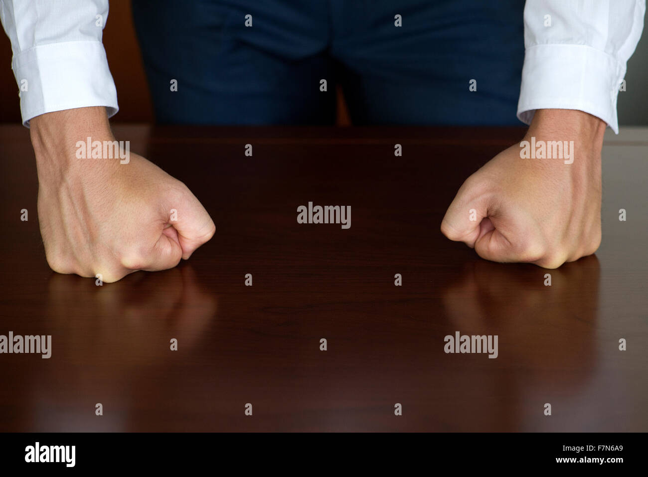 Businessman clenching fists, cropped - Stock Image