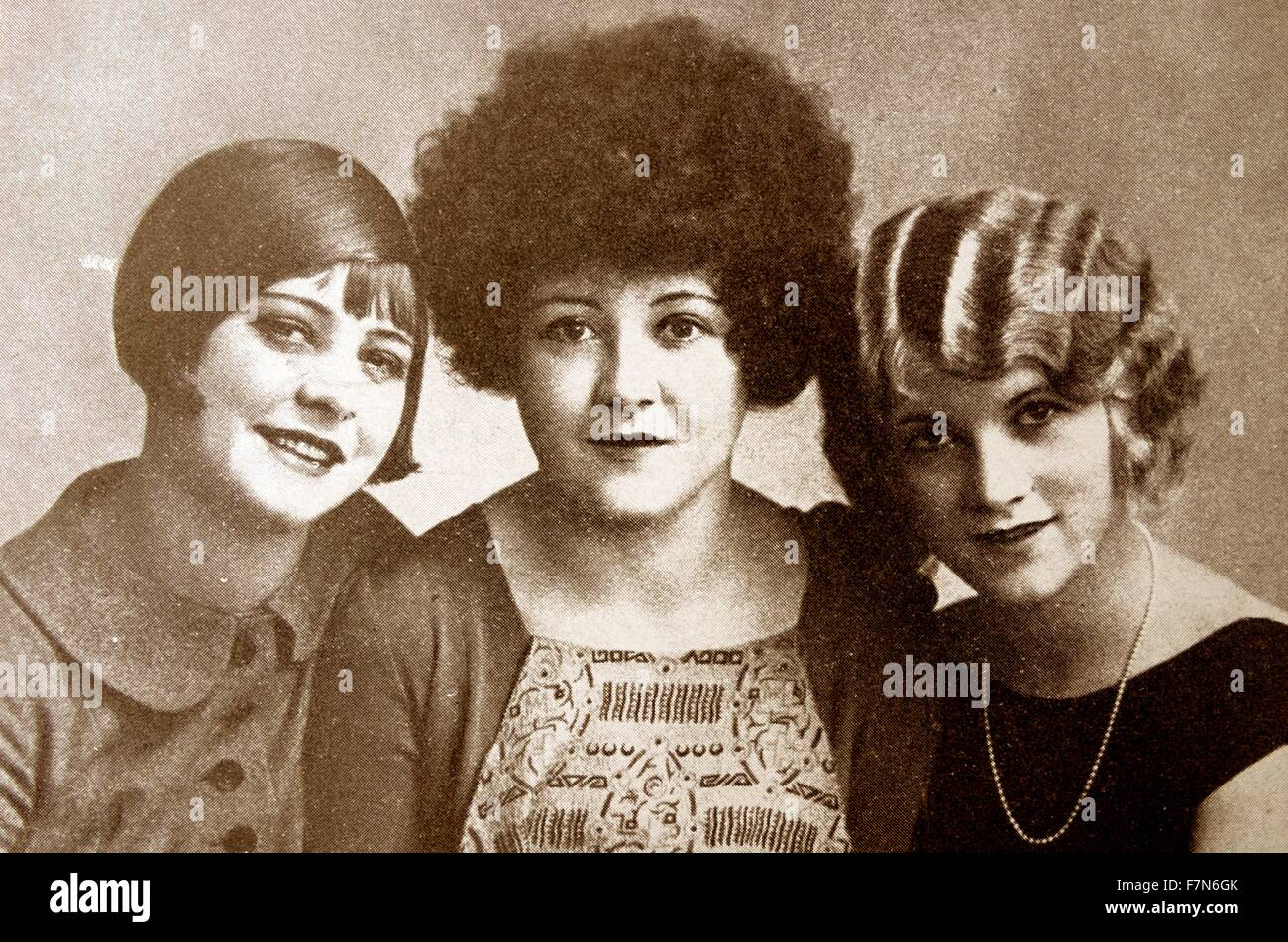 Although these three widely differing styles seem comical, they were considered to be chic in the 1920s when short - Stock Image