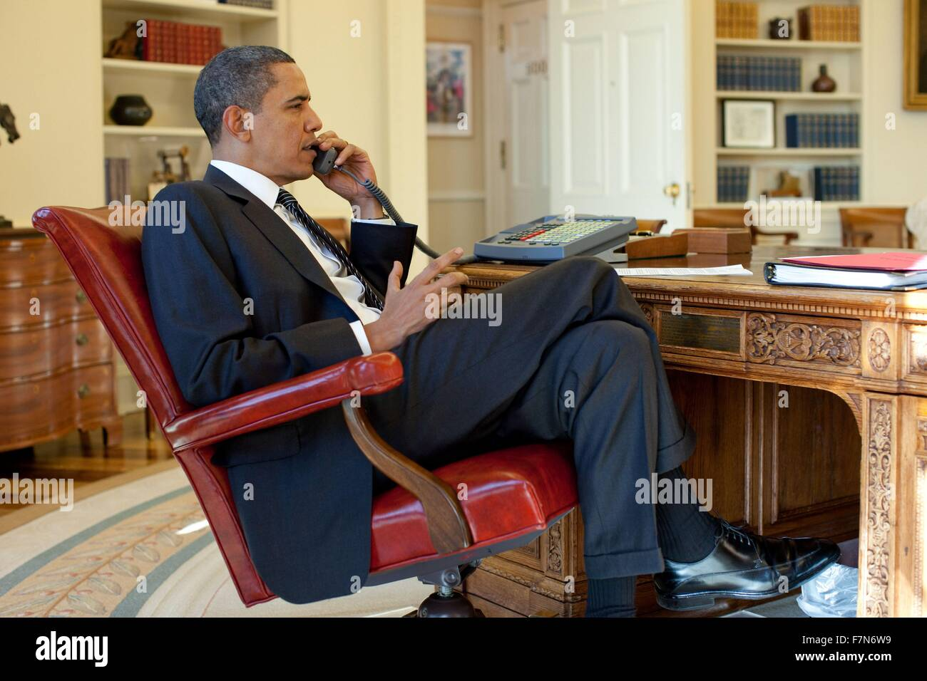 Barak Obama on the phone in the Oval Office with Rene Preval, 2010. - Stock Image