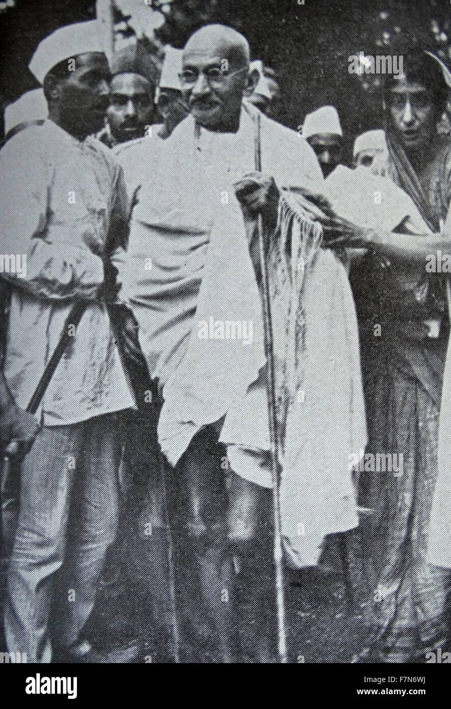Mahatma Gandhi, Indian mystic and political leader, with some of his followers. 1930 - Stock Image