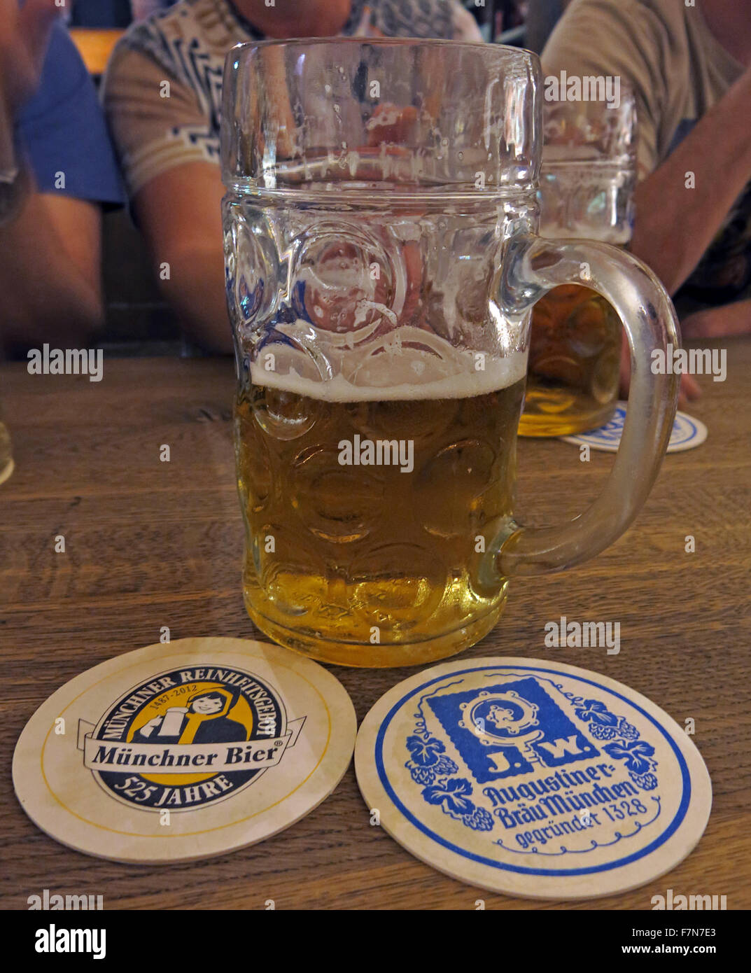 Oktoberfest in Munich,Baveria,Germany,Stein and two beer mats - Stock Image