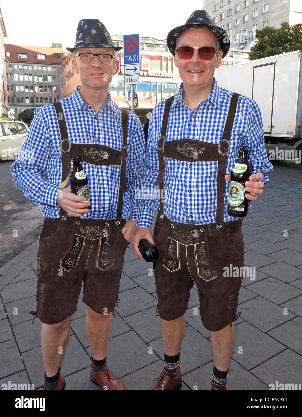 Oktoberfest in Munich,Baveria,Germany. Two Tourists in Lederhosen, Stock Photo