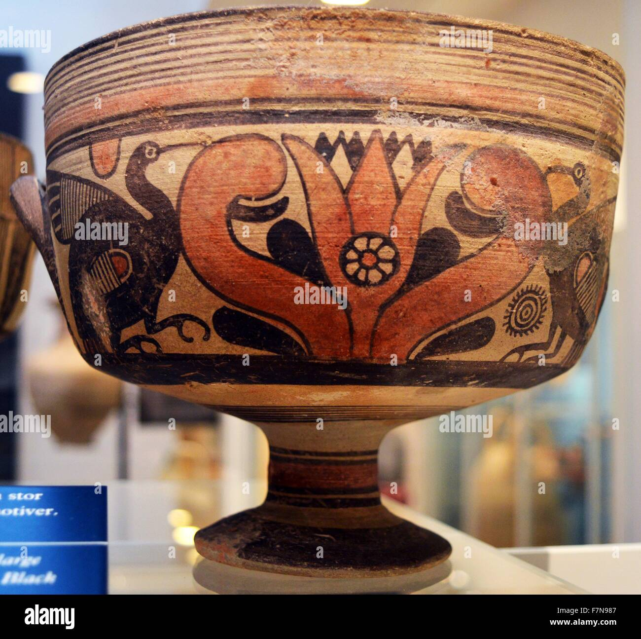 Two handled bowl decorated with long necked birds and a large stylised lotus flower. Dated 750 B.C. - Stock Image