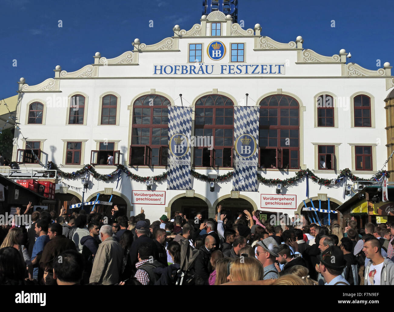 Munich Oktoberfest in Germany  Volksfest beer festival and travelling funfair, Hofbrau Festzelt - Stock Image