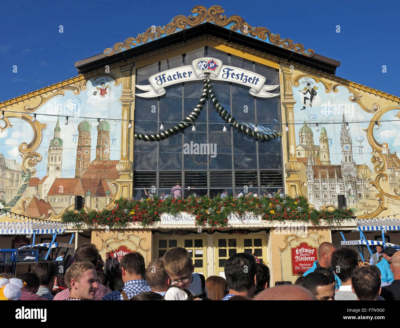 Munich Oktoberfest in Germany  Volksfest beer festival and travelling funfair, Hacker-Festzelt with people - Stock Image