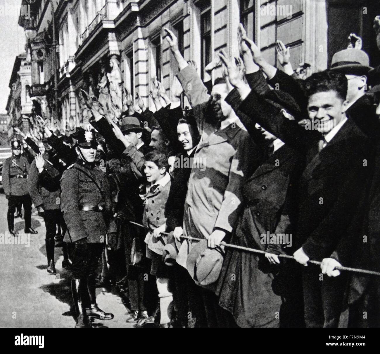 Photograph of German youths saluting in support of Adolf Hitler. Dated 1940 - Stock Image