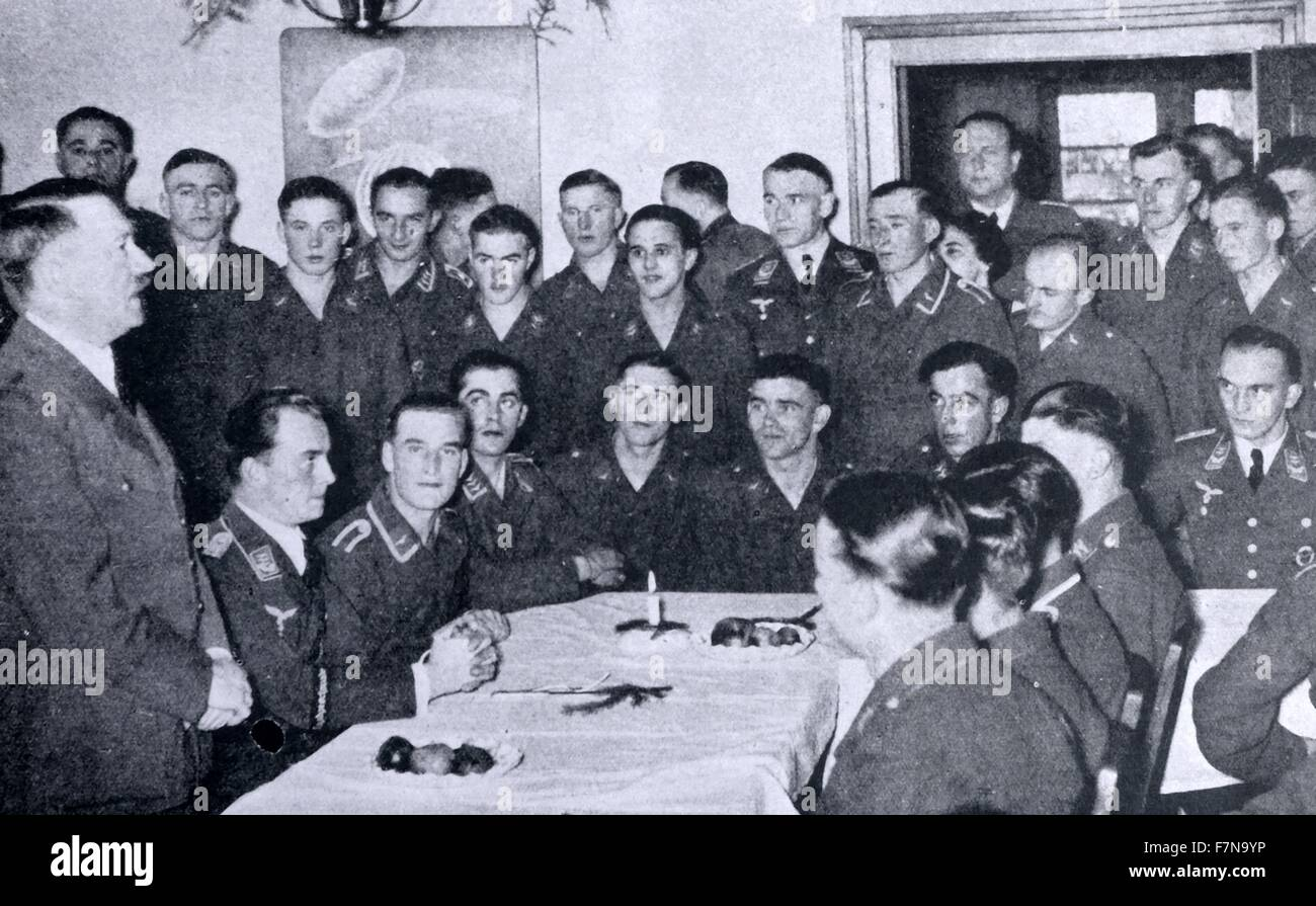 Photograph of Adolf Hitler meeting Nazi airmen at Christmas. He addresses the personnel of an aerodrome in the vicinity - Stock Image