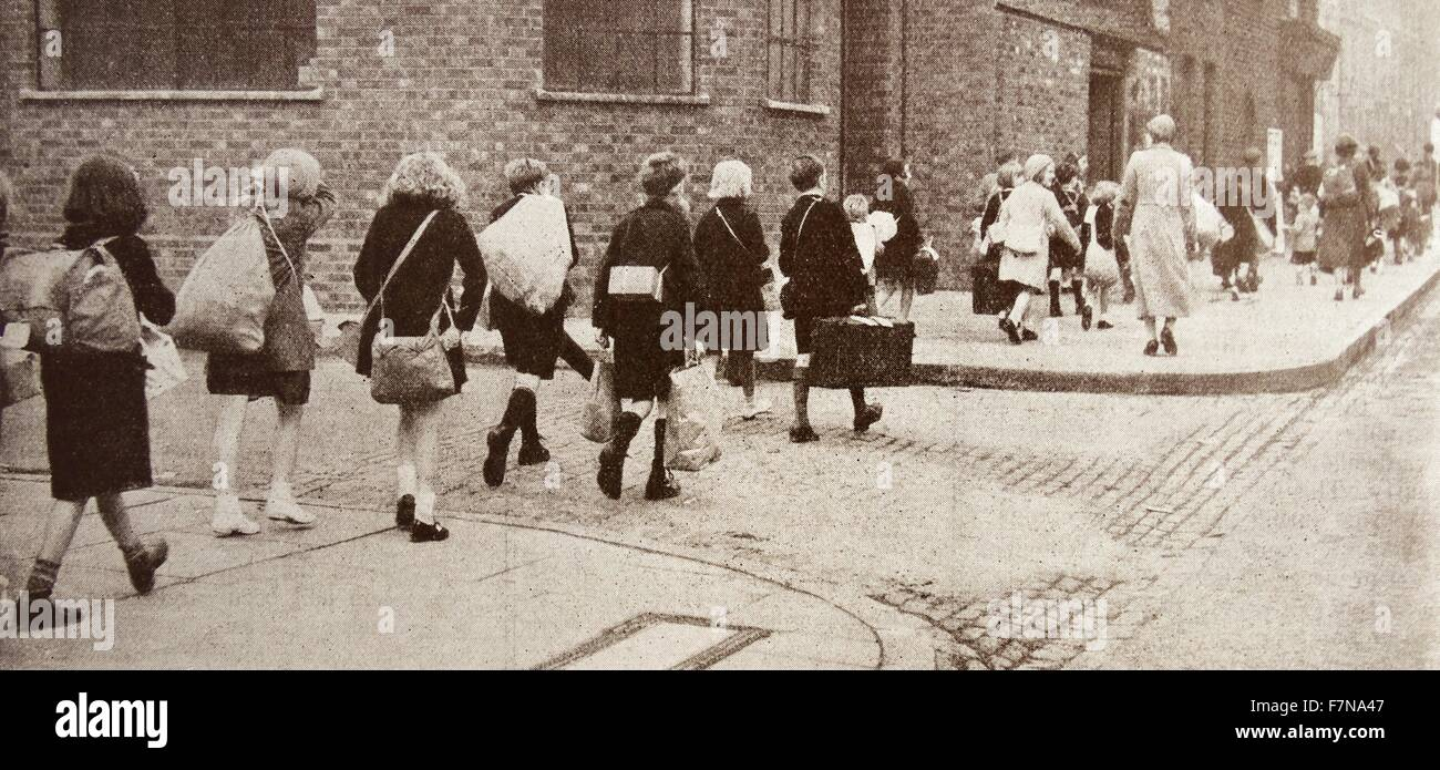 Photograph of British children from the Benwell Road School, being evacuated through the streets whilst wearing - Stock Image
