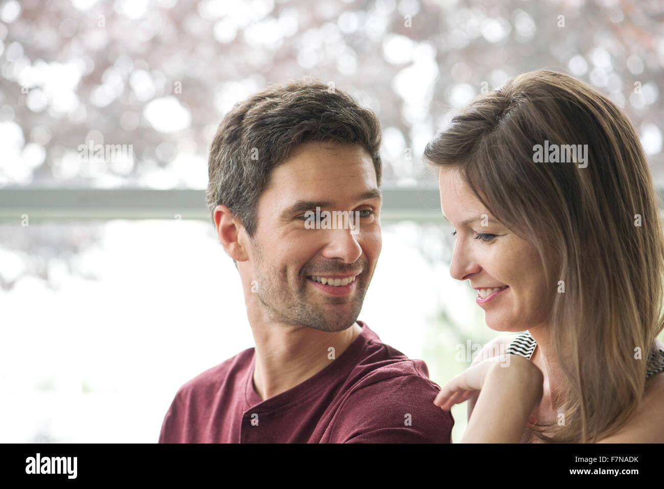 Couple smiling together - Stock Image