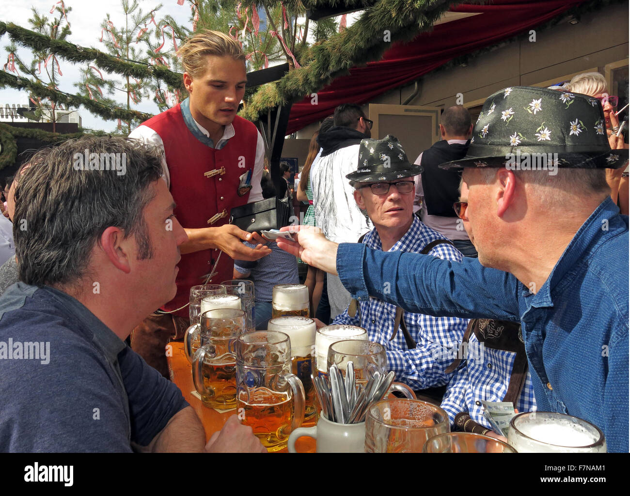 Paying for beer at Oktoberfest,Munich,Bavaria,Germany Stock Photo