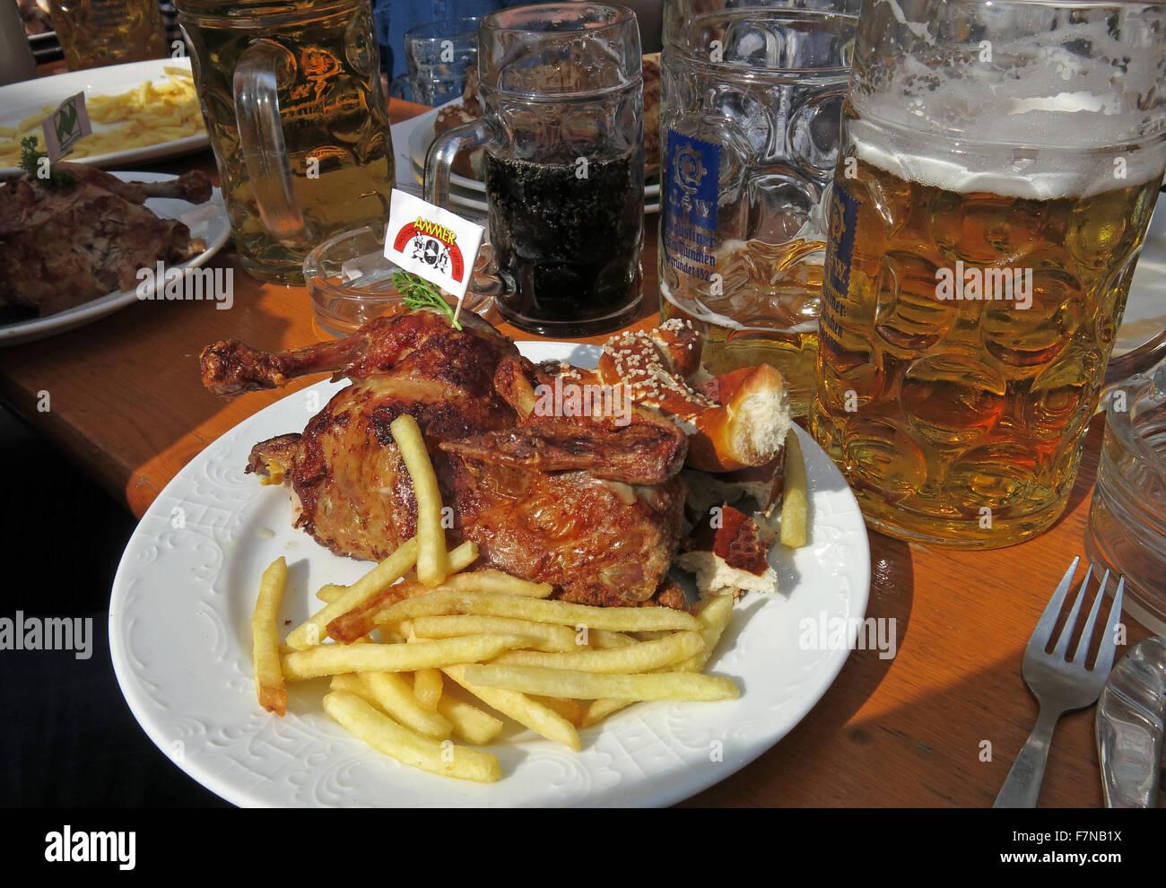 Oktoberfest beer steins and festival food, half chicken & fries, Munich, Germany - Stock Image