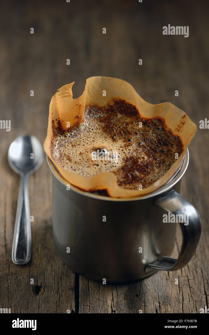 Ground coffee in cup and filter holder Stock Photo