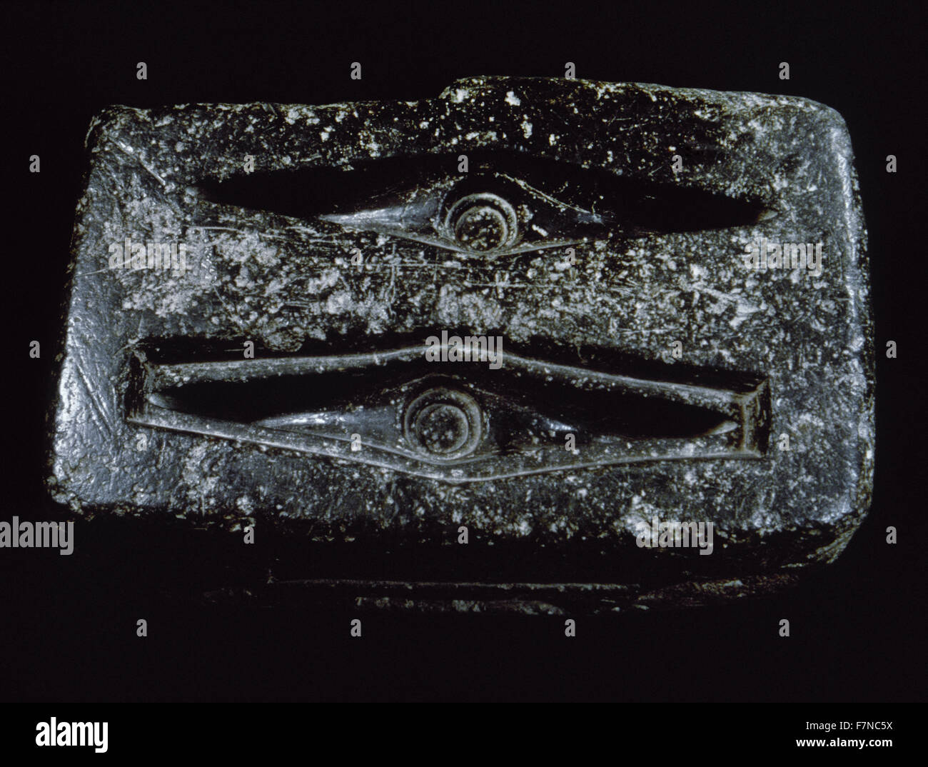 Italy. Sardinia. Nuragic civilization. Matrix used in the fusion of an ax and a knife. 10th century BC. From Belvi. - Stock Image