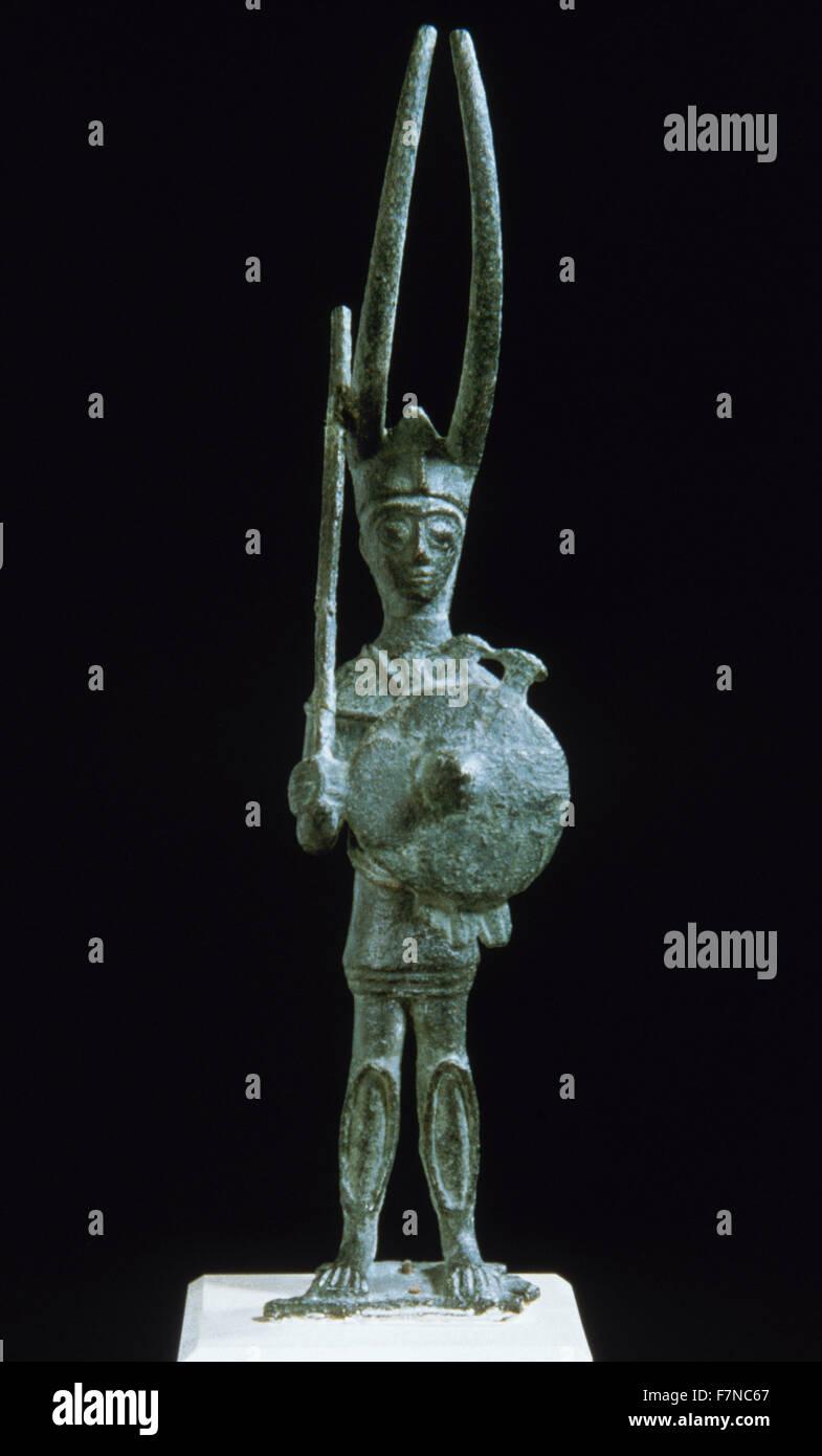 Italy. Sardinia. Nuragic civilization. Statuette of a warrior. Know as the Miles Cornutus. It represents of the - Stock Image