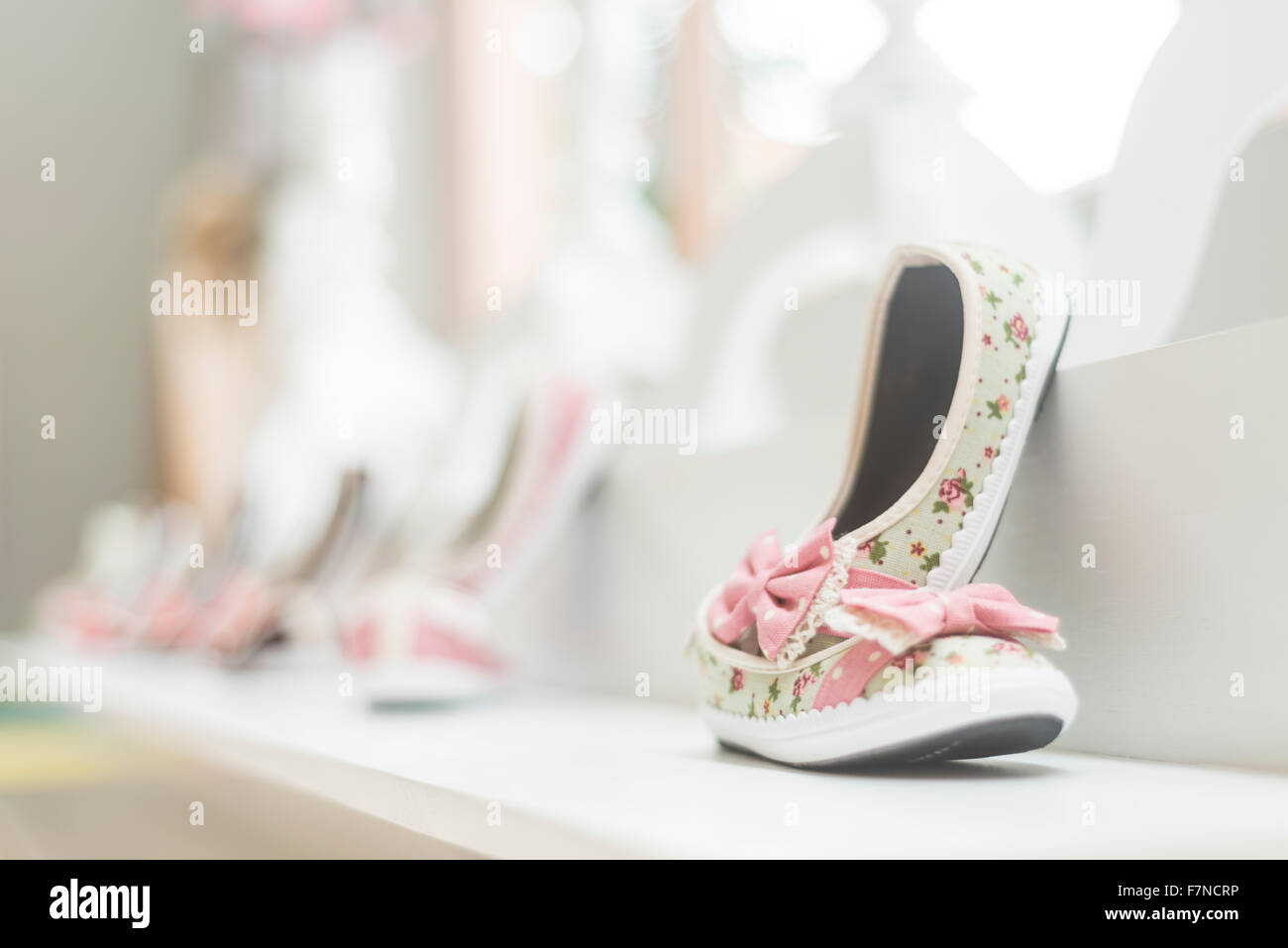 young girl shoes in children footwear shop display - Stock Image