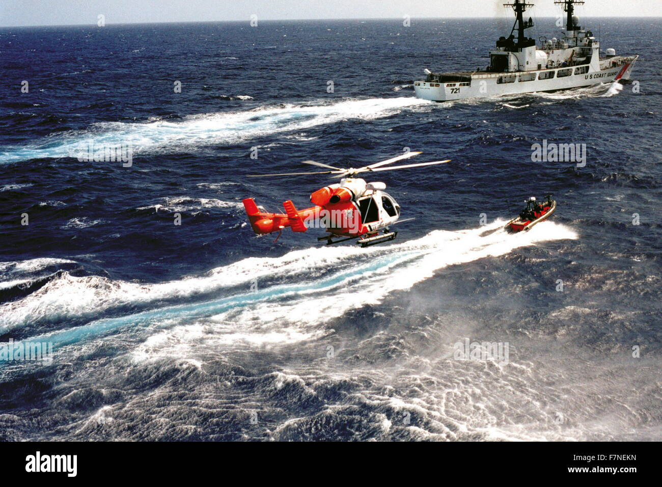 US Coastguard patrol boat with dinghy and helicopter 2012 - Stock Image