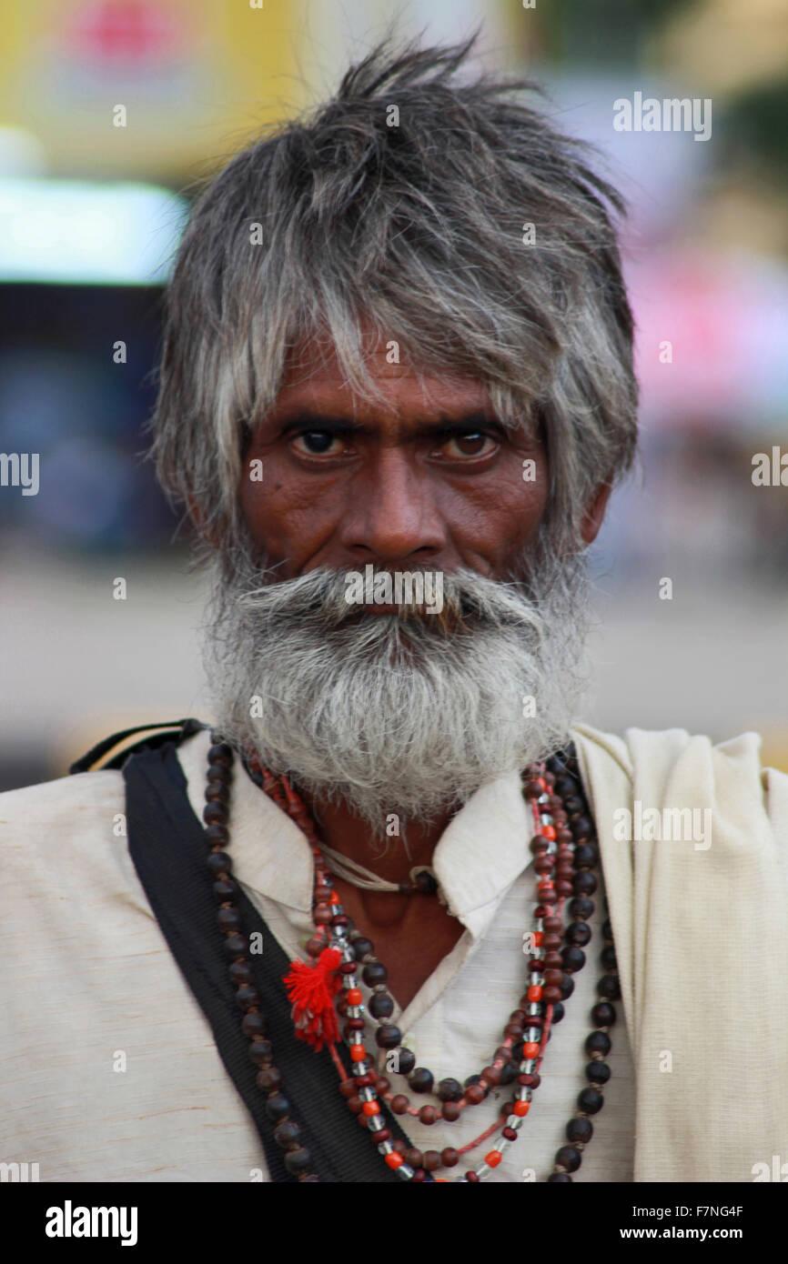 Sadhu with beaded necklace. Kumbh Mela ,Nasik, Maharashtra, India - Stock Image
