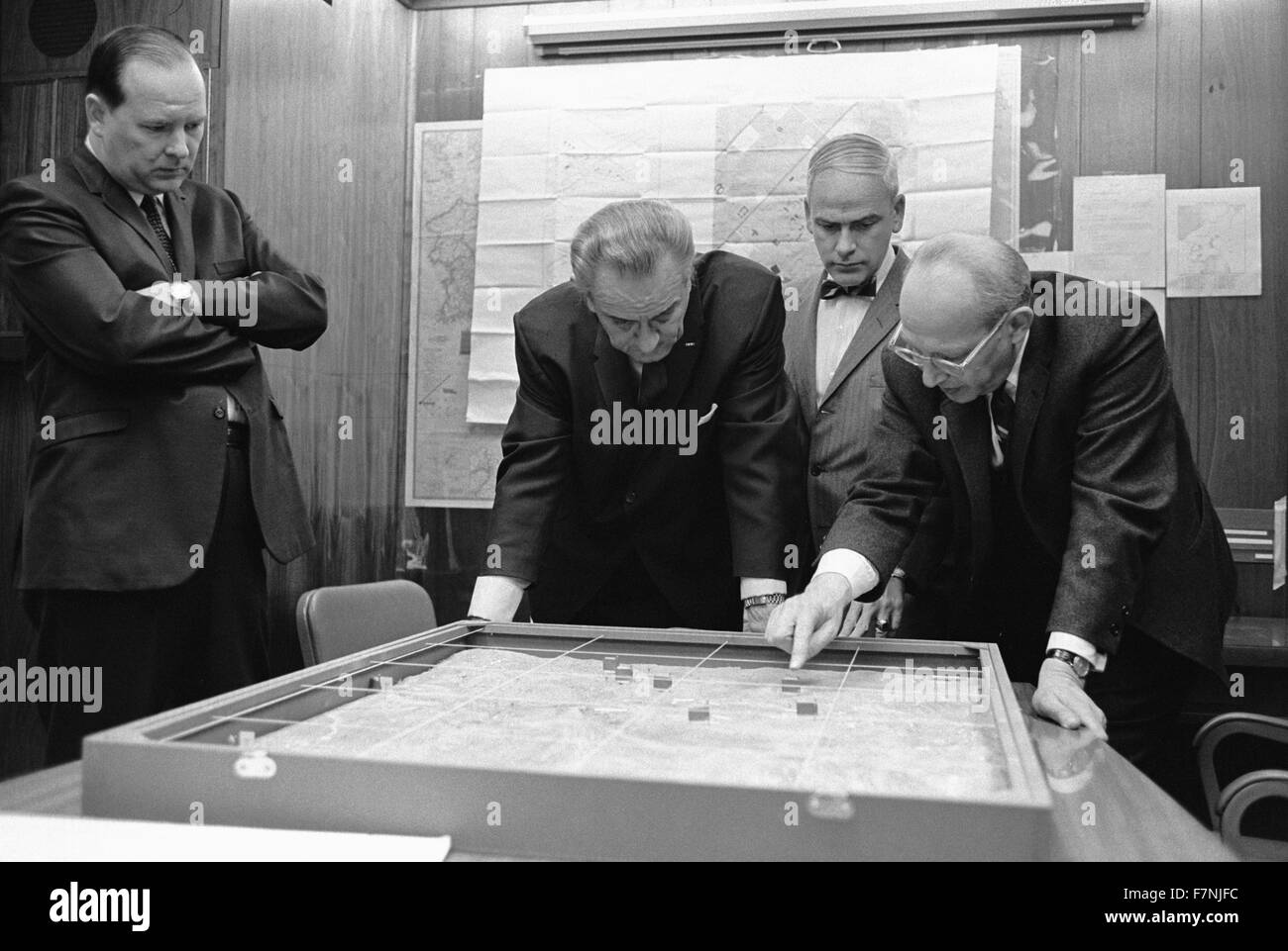 White House Situation Room. Walt Rostow shows President Lyndon Johnson, options for a military attack on a site - Stock Image