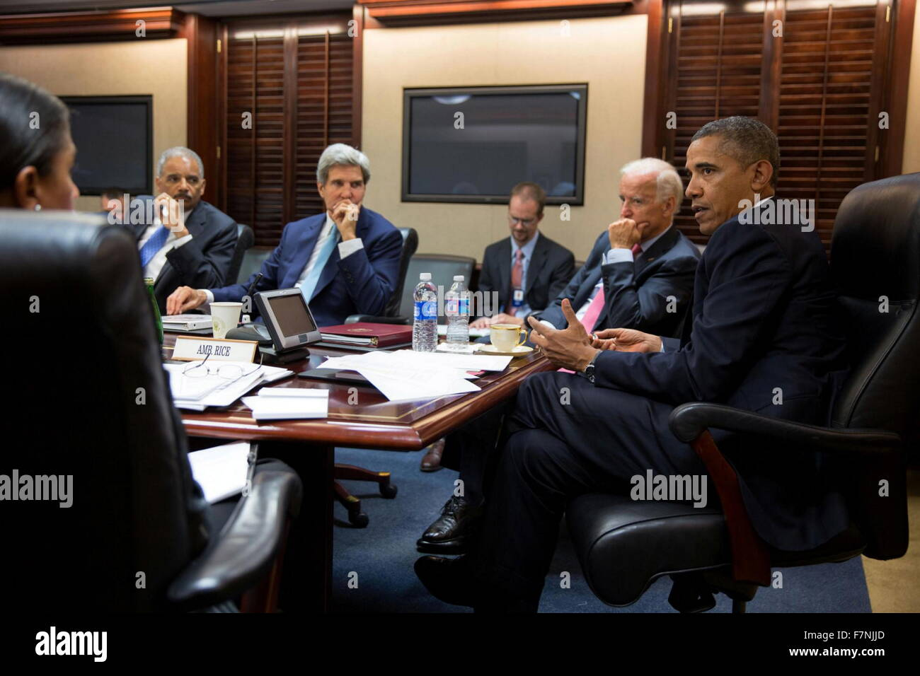 president Barack Obama in the White House situation room with administration officials seated left to right: Eric - Stock Image