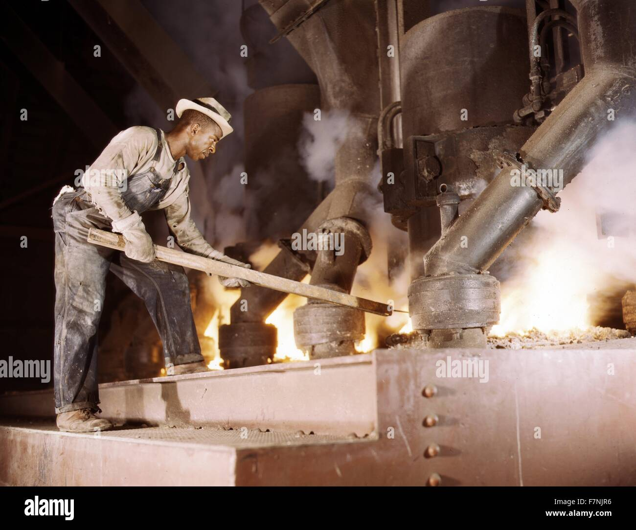 A large electric phosphate smelting furnace used to make elemental phosphorus in a TVA chemical plant in the vicinity - Stock Image