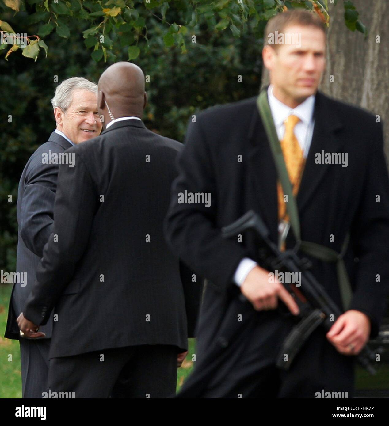 President George W Bush is guarded by Secret Service Agents during his first term as President 2004 Stock Photo