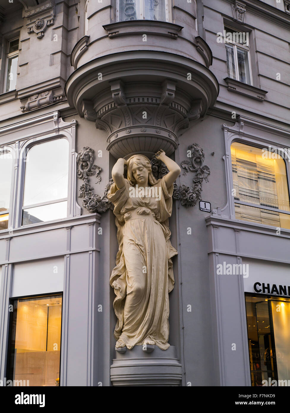 Caryatid on corner of Vienna store Austria Europe - Stock Image