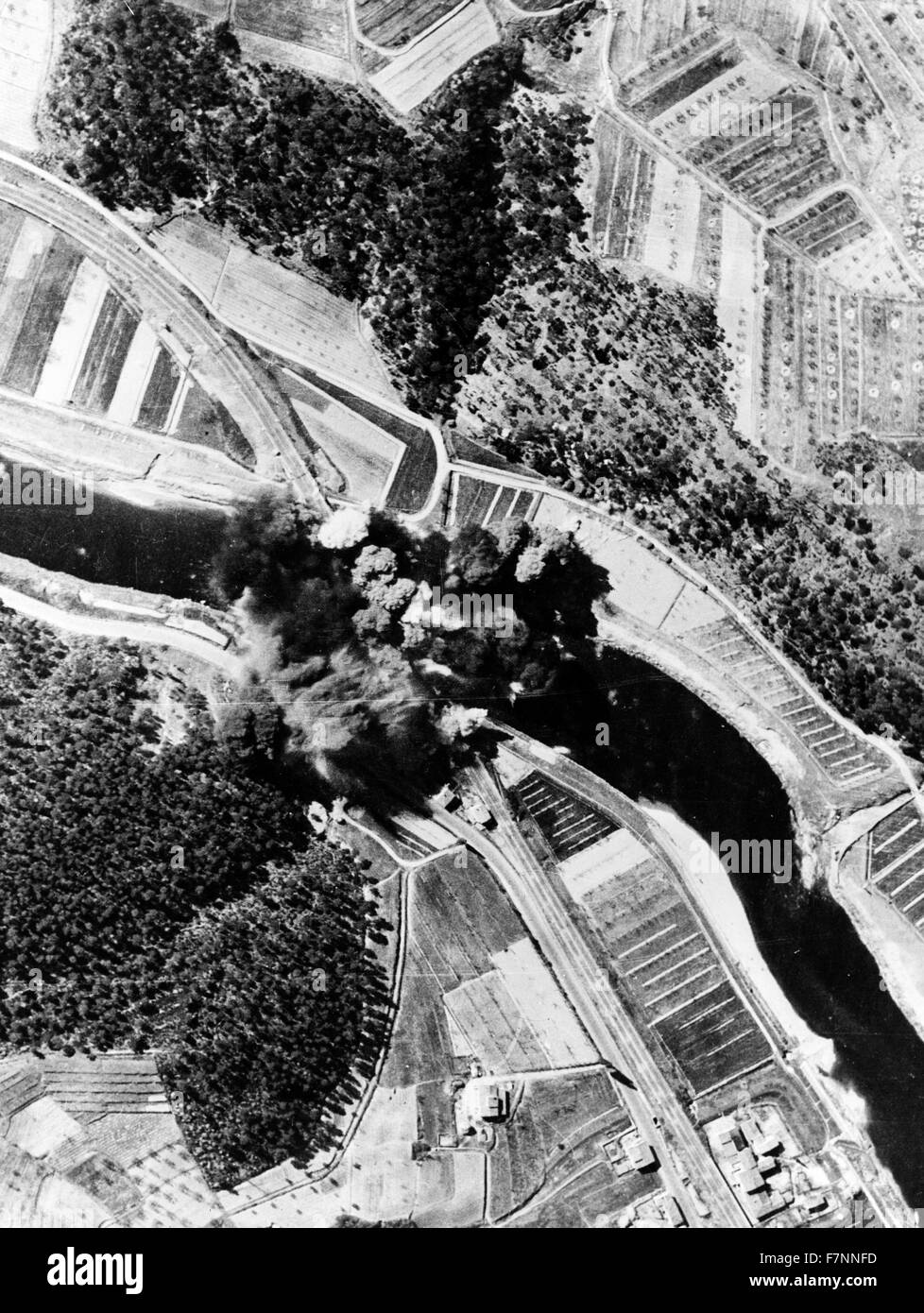 Smoke shrouds the Signal Bridge. Another target for Operation Strangle, the Signal Bridge, west of Florence, was - Stock Image