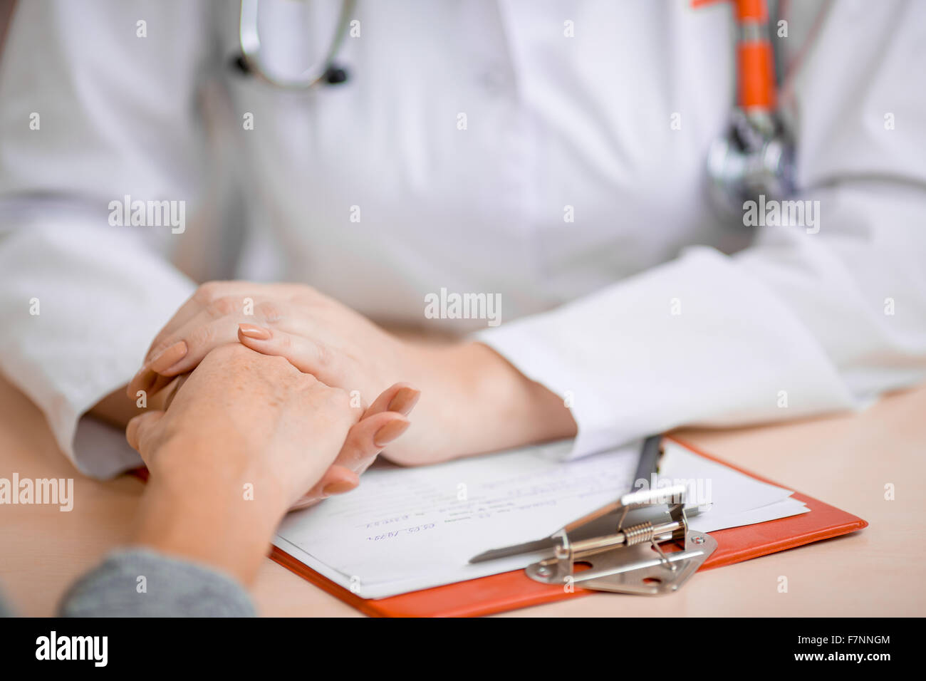 Doctor consoling or supporting patient Stock Photo