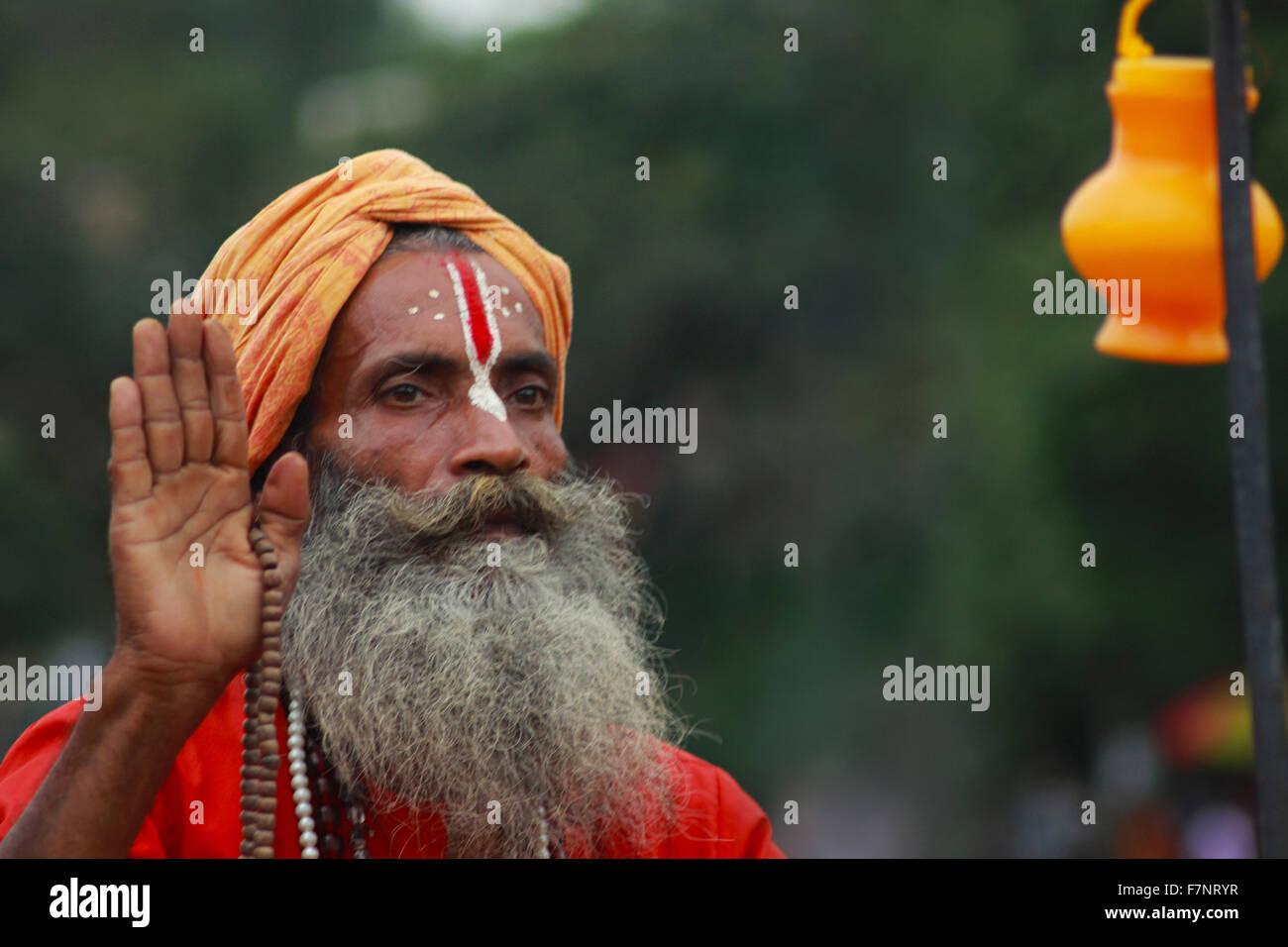 Sadhu offering blessing Kumbh Mela, Nasik, Maharashtra, India - Stock Image