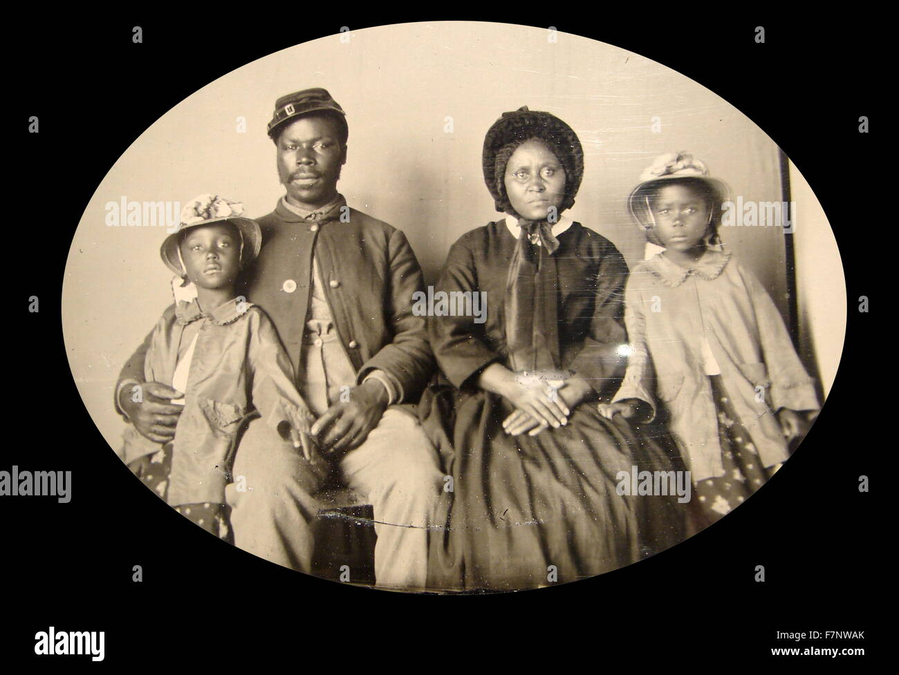 photograph of an African American, Civil War, Union soldier with his family. c1863-65 - Stock Image