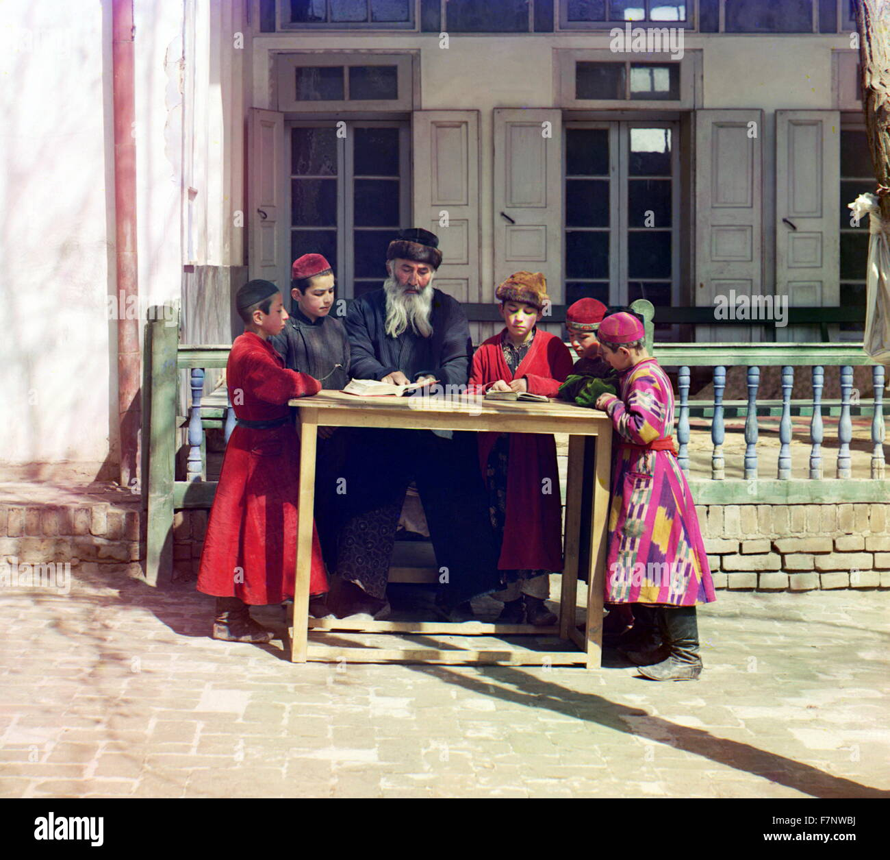 Color photograph of Jewish Children with their Teacher in Samarkand; Russian Empire. by Russian photographer, Prokudin - Stock Image