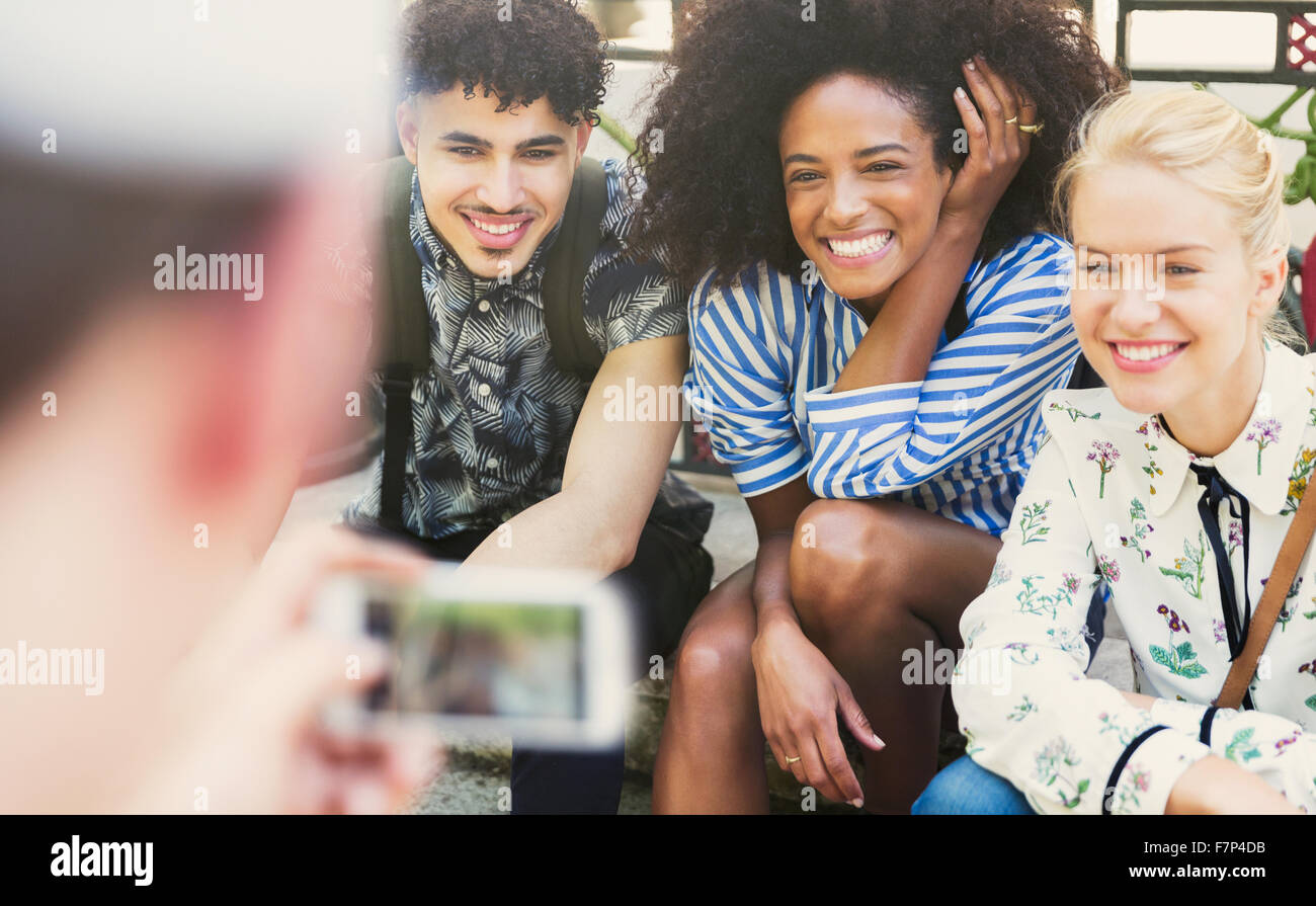 Enthusiastic friends being photographed - Stock Image