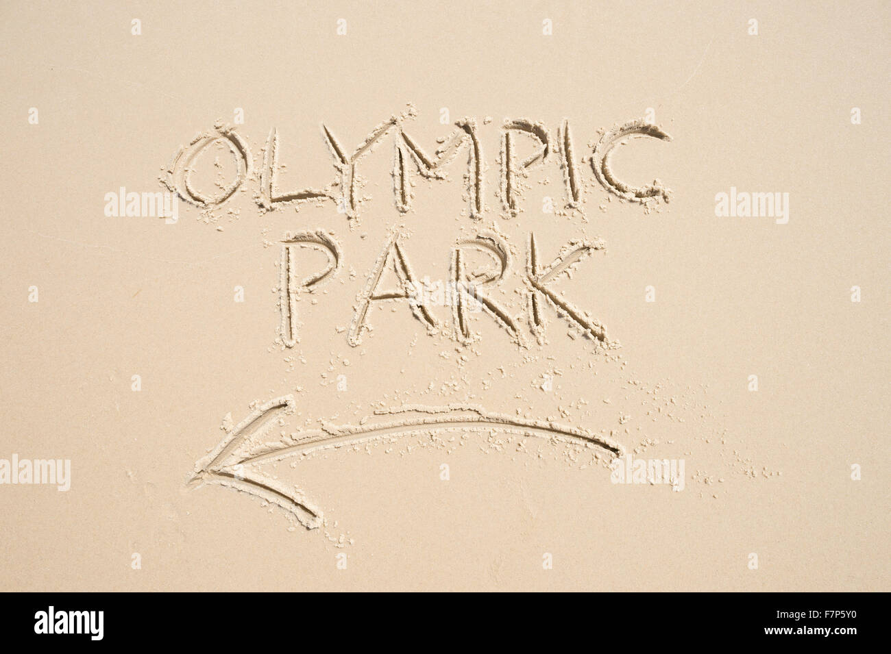 RIO DE JANEIRO, BRAZIL - NOVEMBER 10, 2015: Handwritten message with arrow pointing the way to Olympic Park written - Stock Image