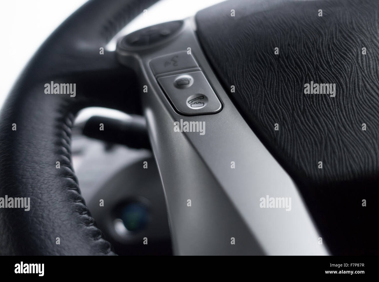 Steering wheel of a Toyota Prius with hands free button - Stock Image