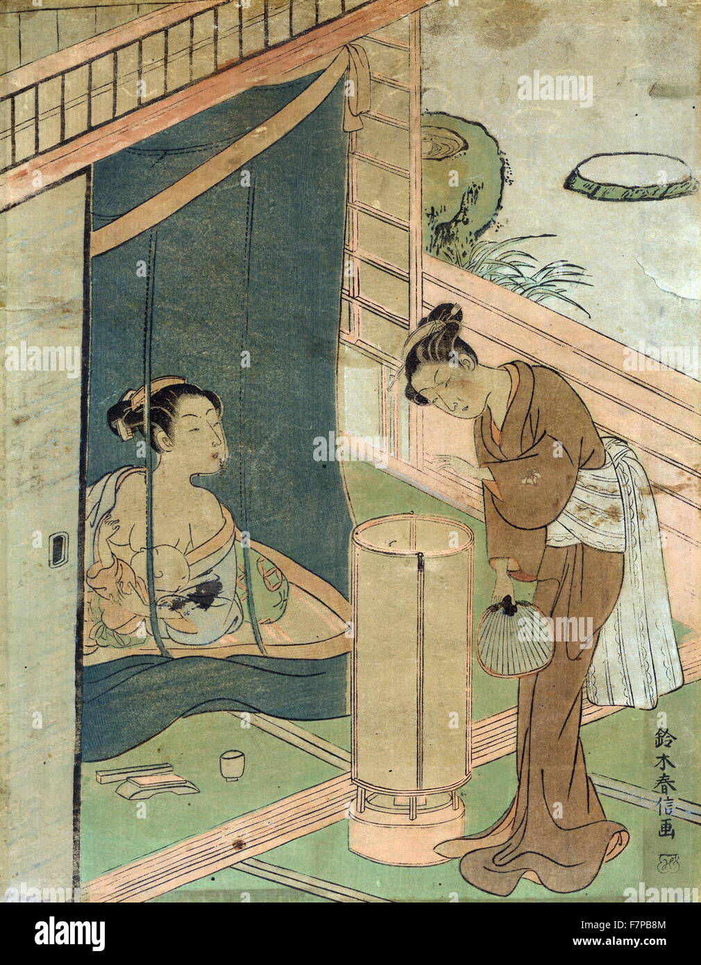 Mother and child behind mosquito netting by Harunobu Suzuki (1724-1770), a Japanese designer of woodblock print - Stock Image