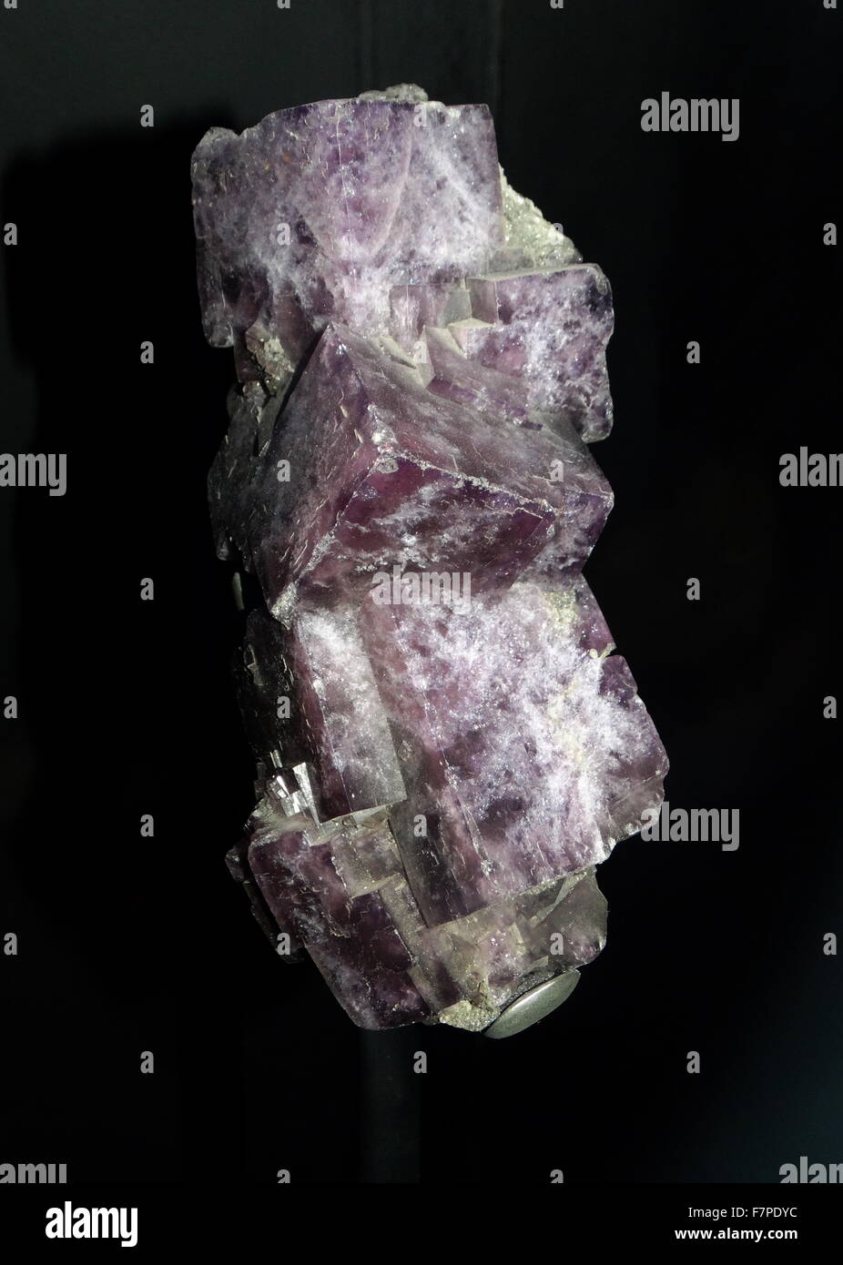 Fluorescent minerals emit visible light when exposed to ultraviolet light - Stock Image