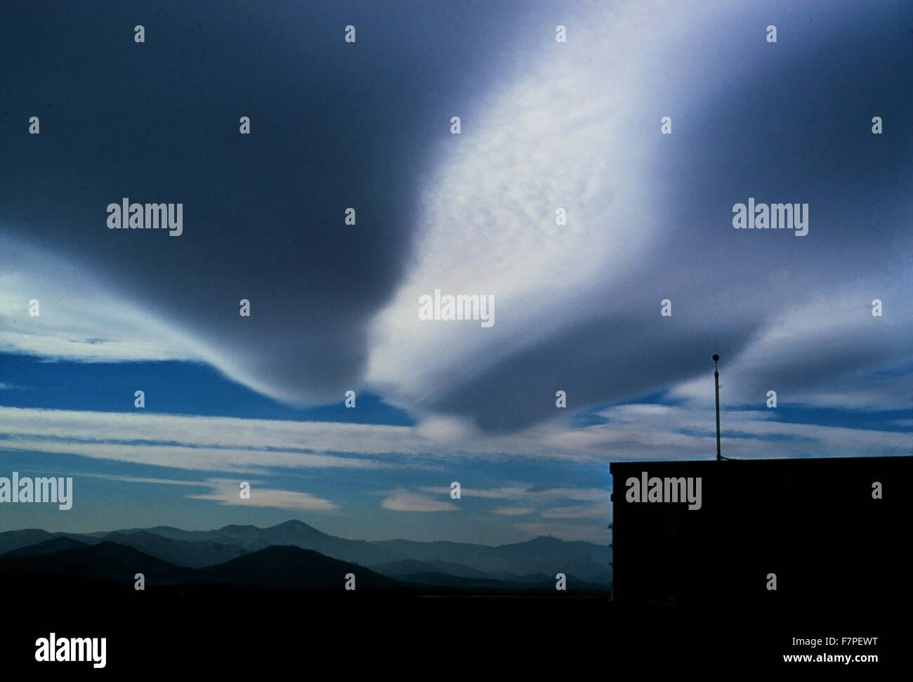 Photograph of a Elongated wave cloud a genus that belongs to the stratocumuliform physical category. Photographed - Stock Image