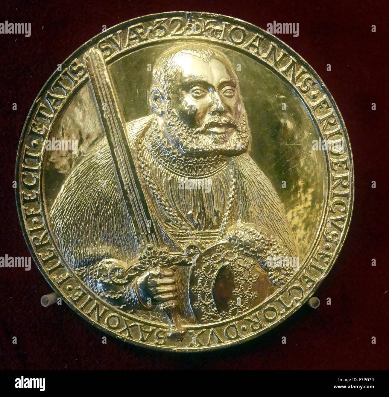 John Huss, made from gilt bronze. - Stock Image