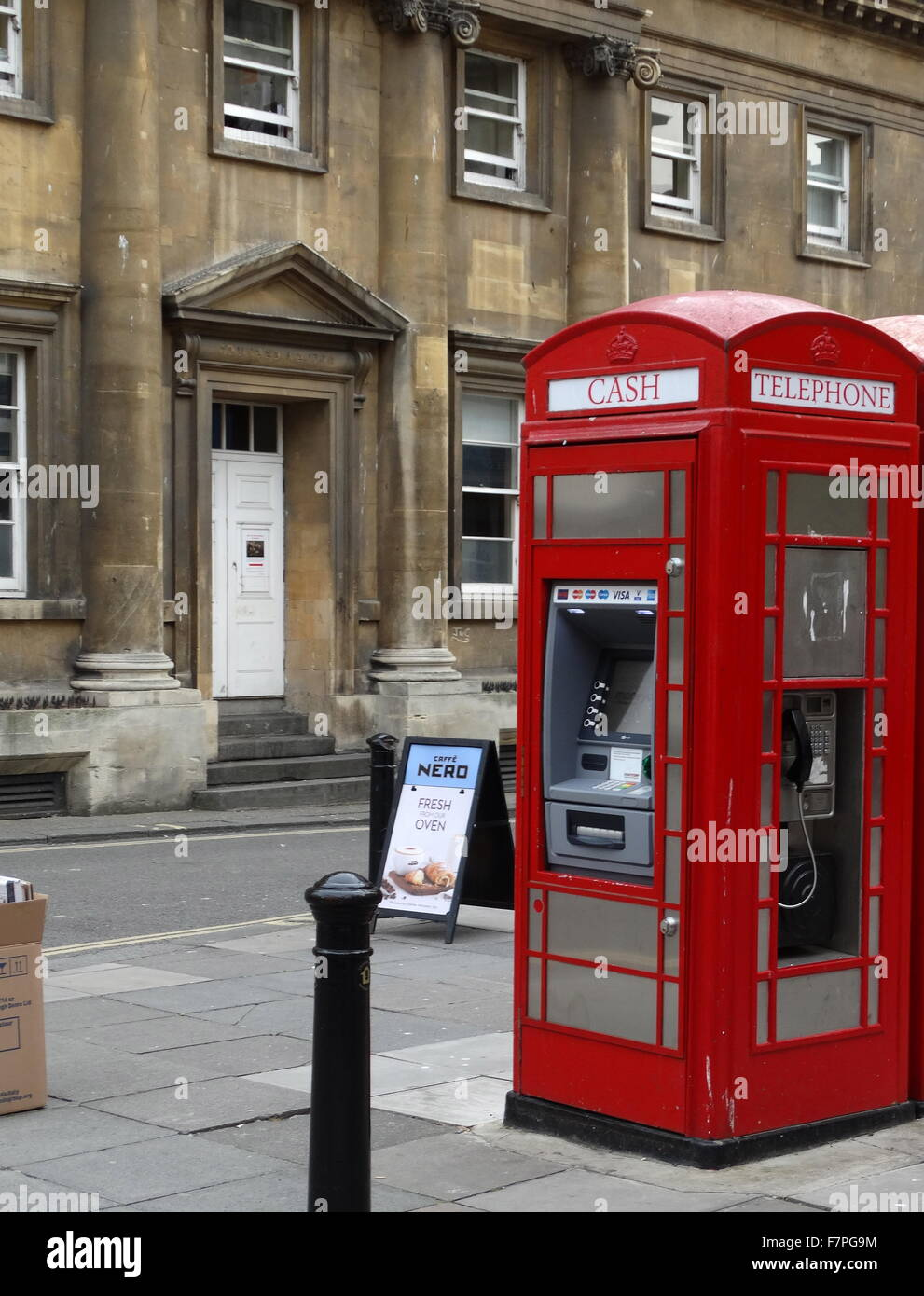 Red telephone kiosk (box). Public telephone designed by Sir Giles Gilbert Scott in 1926 and used across the United - Stock Image