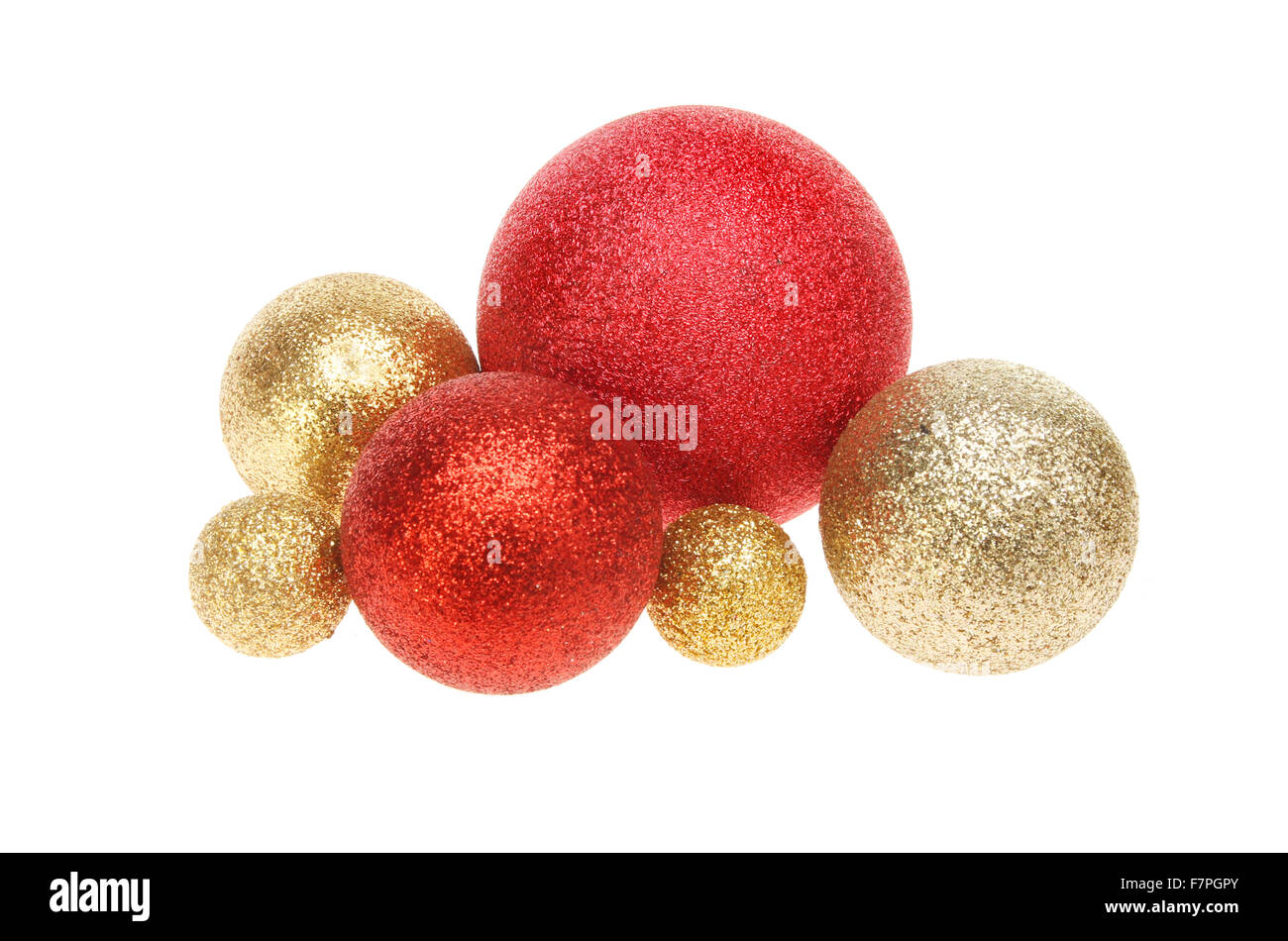 ce3e3fcdd9c0 Group of red and gold glitter Christmas baubles isolated against white