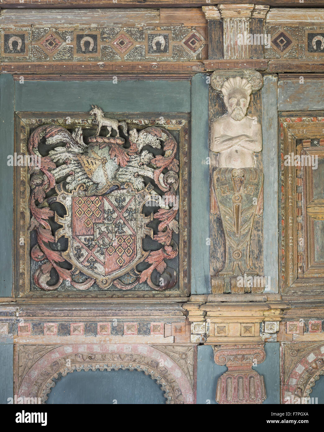 Detail of the elaborate wooden chimneypiece (c.1629) in Henry Ferrer's Bedroom, Baddesley Clinton, Warwickshire. - Stock Image