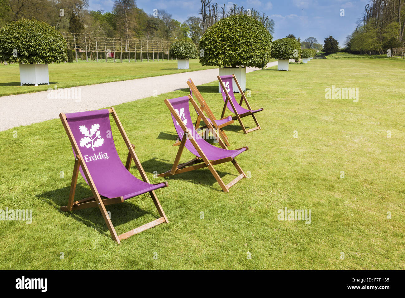 National Trust deckchairs on the lawn in the gardens of Erddig