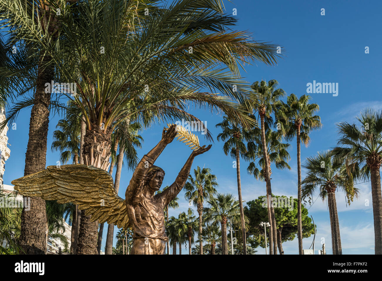 Golden sculpture in front of Carlton Hotel,  Palm tree, Cannes, Cote d'Azur, France, - Stock Image