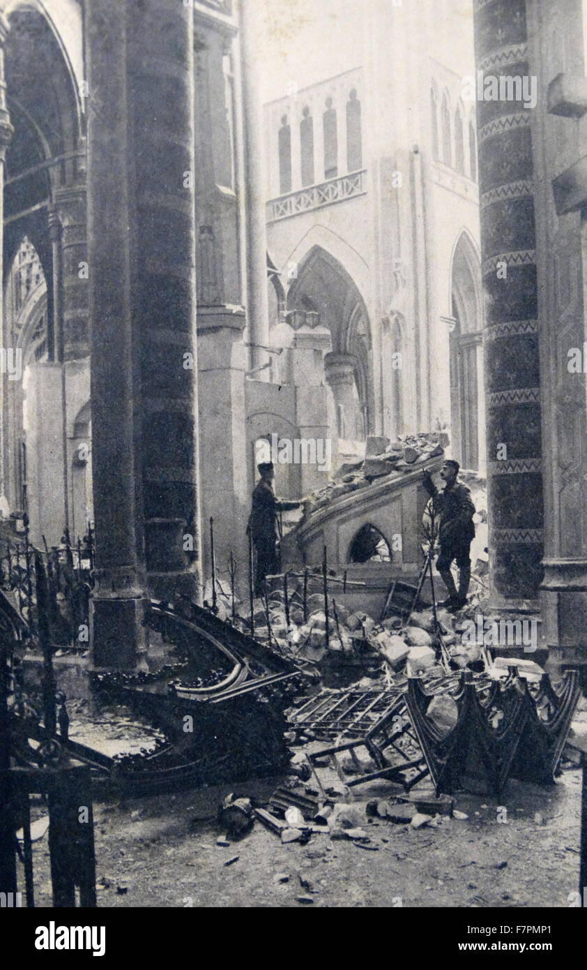 Photograph showing the aftermath of the bombing of the Cathedral of San Quintin, France. Dated 1916 - Stock Image