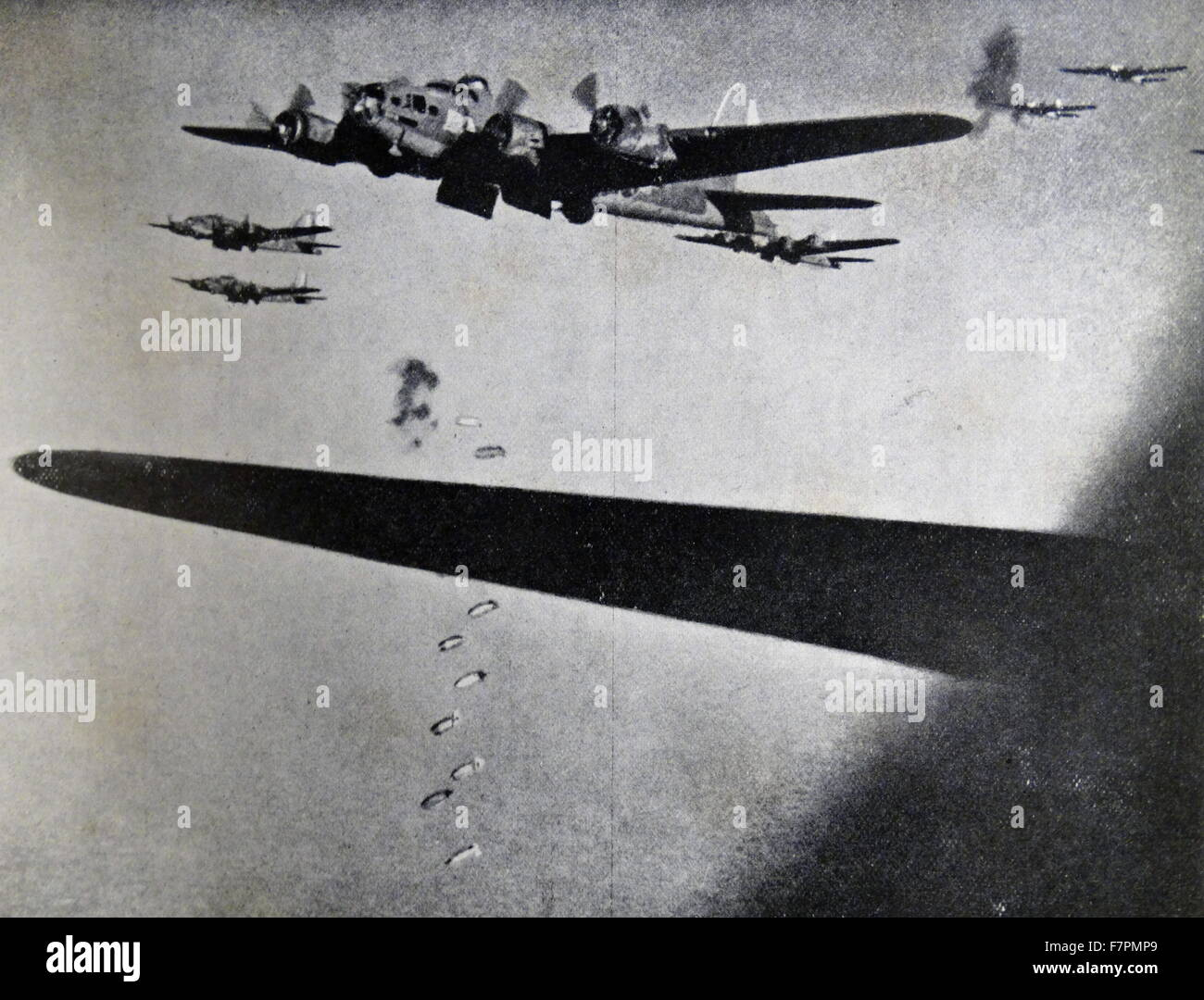 Photograph of Boeing B-17 Flying Fortresses dropping bombs during the Second World War. Dated 1941 Stock Photo